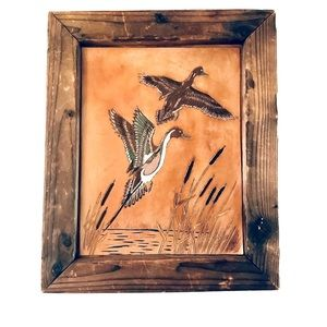 Vintage handcrafted etched leather art